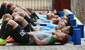 Australian Socceroos football players stretch during a team training run in Vitoria, Brazil on June 4, 2014, as they prepare for the 2014 FIFA World Cup in Brazil. AFP PHOTO/William WEST (Photo credit should read WILLIAM WEST/AFP/Getty Images)